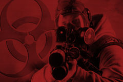 Rebel with gas mask and rifles against a white background Royalty Free Stock Photos