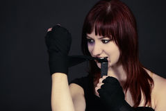 Rebel girl fist boxing bandage. The girl draws a boxing bandage teeth Stock Image