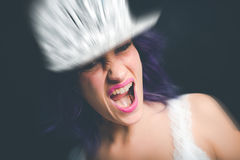 Rebel girl shout. Grimace of a rebel young girl Royalty Free Stock Images