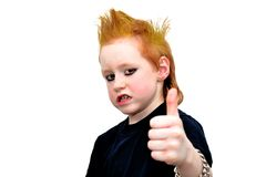 Rebel kid. With yellow hair making scary face Stock Images
