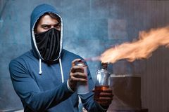 The rebel with molotov cocktail in dark room Stock Photos