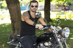 Rebel motorcycle rider on a chopper Royalty Free Stock Images