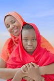 Rebel preteen in the arms of her mother Stock Photography
