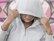 Rebel preteenager wearing a hooded sweatshirt Stock Image