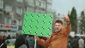 Rebel screams and waves hand. Fist revolution activist fighting on street city.