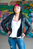 Rebel teen girl. Teen girl with interesting hair and piercing in front of grafitti wal Royalty Free Stock Photos