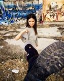 Rebel woman kicking Stock Photo