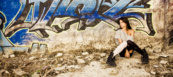 Rebel young girl. Sat in a dirty place Stock Photo