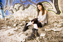 Rebel young girl. Sat in a dirty place Stock Photos