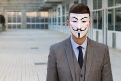 Rebelde anónimo con el espacio de la copia fotografía de archivo