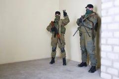 Rebeldes com AK 47 e metralhadora Fotos de Stock