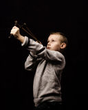 Rebellion. Little boy shooting with a slingshot Stock Images