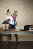 Rebellion at work,secretary destroys office. Business person Royalty Free Stock Images
