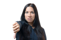 Rebellious negative woman giving a thumb down Stock Photos