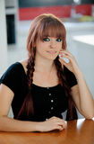 Rebellious teenager girl with red hair at home Stock Image