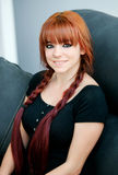 Rebellious teenager girl with red hair at home Royalty Free Stock Photos