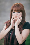 Rebellious teenager girl with red hair Stock Images