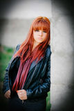 Rebellious teenager girl with red hair Stock Photos