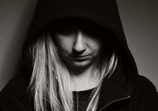 Rebellious teenager in hood. Royalty Free Stock Photography