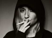 Rebellious teenager in a hooded sweatshirt. Royalty Free Stock Images
