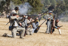 Rebels in Action. North and South scouts fight during a Civil War reenactment at Hawes Farm in Anderson, California on October 4, 2015 Stock Photography