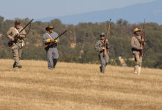 Rebels Advance. Confederates move down the ridgeline during a Civil War Reenactment at Anderson, California Stock Photography