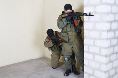 Rebels with AK 47. Inside the building Royalty Free Stock Photography