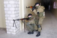 Rebels with AK 47 and machine gun. Inside the building Stock Image