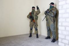 Rebels with AK 47 and machine gun. Inside the building Stock Photos