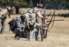Rebels on the Hill. Union and Confederates engage in combat, Civil War reenactment, Anderson, California Royalty Free Stock Photo