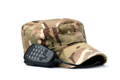 Rebels multicam cap and microphone on white. Rebels multicam cap and microphone isolated on white Stock Images