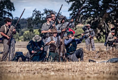 Rebels Stand Ready. Rebel soldiers stand ready for combat during a Civil War Reenactment at Anderson, California Royalty Free Stock Image