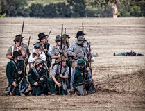 Rebels Stand Ready. Rebel soldiers stand ready for combat during a Civil War Reenactment at Anderson, California Royalty Free Stock Photography