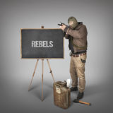 Rebels text on blackboard with terrorist Royalty Free Stock Photo