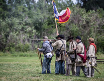 Rebels at War. Red Bluff, California, United States-April 25, 2015: Confederate soldiers fire at Union positions during a Civil War reenactment Stock Photo