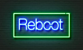 Reboot neonteken op bakstenen muurachtergrond Stock Fotografie