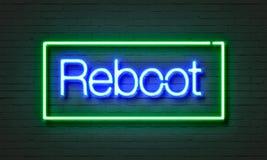 Rebootneontecken på bakgrund för tegelstenvägg Arkivbild