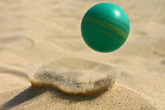 Rebound. Green ball rebounded from the sand Royalty Free Stock Photography