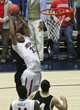 A Rebound by Arizona Wildcat Jesse Perry. Tucson, Arizona - December 22: McKale Arena on December 22, 2011, in Tucson, Arizona. The University of Arizona Royalty Free Stock Images
