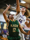 Rebound Battle. Basketball action with Placer vs. Shasta High School in Redding, California Stock Photo
