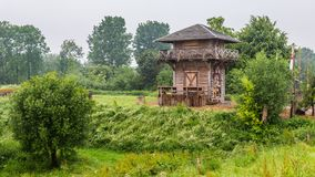 Roman watch tower Netherlands. Rebuild of a Roman watch tower along the Rhine between Kesteren and Wageningen in the Netherlands stock photo
