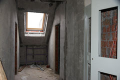 Rebuilding apartments. The room during renovation. Concrete interior. Development. Stock Images