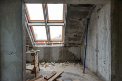 Rebuilding apartments. The room during renovation. Concrete interior. Development. Stock Photography