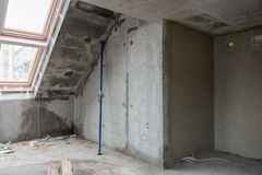 Rebuilding apartments. The room during renovation. Concrete interior. Development. Stock Photos