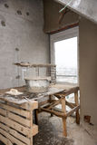 Rebuilding apartments. The room during renovation. Concrete interior. Development. Stock Photo