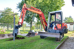 Rebuilding a house and digging dirt with excavator Stock Images