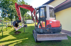 Rebuilding a house and digging dirt with excavator Stock Photos