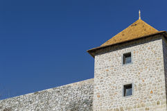 A rebuilt castle. An old castle undergoing renovation. Left side is an old Roman wall, while the right side is the renovated and rebuilt tower. The photograph is royalty free stock photos