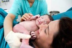 Recém-nascido e mãe no hospital Imagens de Stock Royalty Free