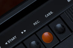 Rec button from a very old cassette player. Record button on a very old cassette player. Forward button next to it Royalty Free Stock Image